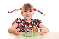 Little girl make family figure with plasticine Stock Photo