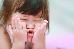 Little girl make a funny face Stock Images