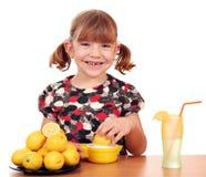 Little girl make lemonade Stock Image