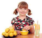 Little girl make lemonade Royalty Free Stock Photos