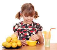Little girl make lemonade Stock Image
