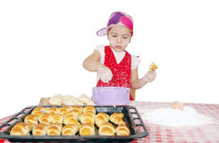 Little girl make rolls Stock Images
