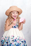 Little girl and make up Stock Photography
