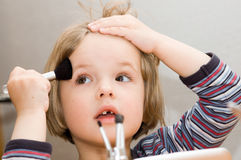 Little girl make up Royalty Free Stock Photos