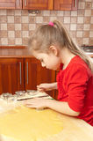 Little girl makes cookies Royalty Free Stock Photography