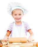 Little girl makes dough Royalty Free Stock Photos