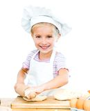 Little girl makes dough Stock Photos