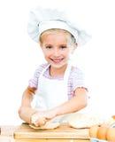 Little girl makes dough Stock Photos