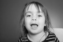 Little girl makes Grimace Stock Photography