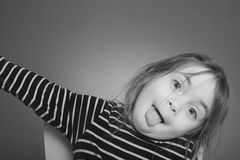 Little girl makes Grimace Stock Images