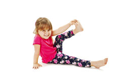 Little girl makes gymnastic exercise Stock Photo