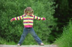 Little girl makes gymnastic in park Royalty Free Stock Images
