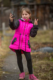 Little girl makes selfie on phone Royalty Free Stock Images