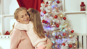 Little girl makes a surprise to her mother for the new year and gives present Royalty Free Stock Images