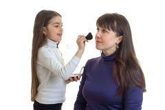 Little girl makeup artist does his mom makeover Stock Images