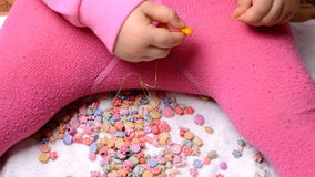Little Girl Making a Beads stock video footage