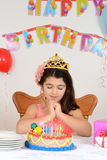 Little girl making birthday wish Royalty Free Stock Images