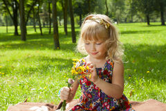 Little girl making a bouquet Stock Photo