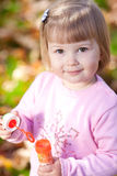 Little girl making  bubble blower on the autumn forest Stock Photography
