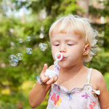 Little girl making bubbles Royalty Free Stock Photos