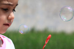 Little girl making bubbles Royalty Free Stock Photo