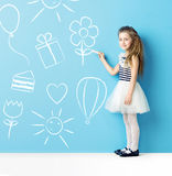 Little girl making chalk drawings Royalty Free Stock Images