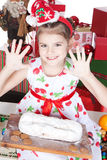 Little girl making Christmas cake Stock Photo