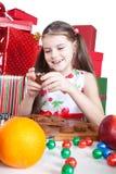 Little girl making Christmas cookies Stock Image