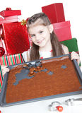 Little girl making Christmas cookies Stock Photography
