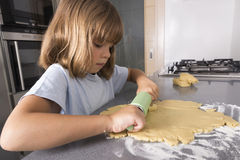 Little girl making cookie dough Royalty Free Stock Images