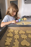 Little girl making cookie dough Royalty Free Stock Photos