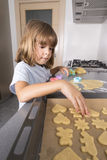 Little girl making cookie dough Stock Photos