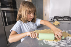 Little girl making cookie dough Stock Photography