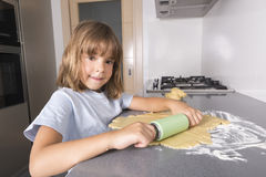 Little girl making cookie dough Royalty Free Stock Photo