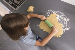 Little girl making cookie dough Stock Images