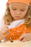 Little girl making cookies series Stock Photos
