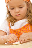 Little girl making cookies series Royalty Free Stock Photo