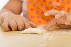 Little girl making cookies series Stock Image