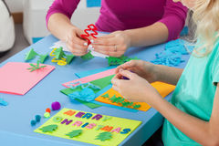 Little girl making crafts with teacher Royalty Free Stock Photo