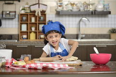 Little Girl Making Dough Royalty Free Stock Image