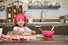 Little Girl Making Dough Stock Photography