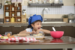 Little Girl Making Dough Royalty Free Stock Photos