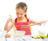 Little girl making dough Royalty Free Stock Images