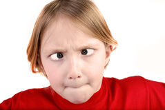 Little Girl Making Face. Little girl wearing red shirt isolated on white making funny face Royalty Free Stock Images