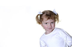 Little Girl Making Faces. Little girl dressed in white making faces expressions Royalty Free Stock Photography