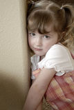Little Girl Making Faces. Little girl in a dress making faces expressions Royalty Free Stock Image