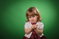 Little girl making faces Stock Photography