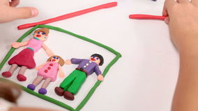 Little girl making a family house from plasticine stock footage