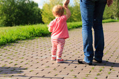 Little girl making first steps in the park Royalty Free Stock Photography