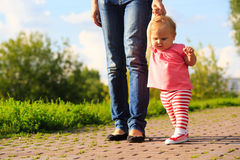 Little girl making first steps in the park Royalty Free Stock Image